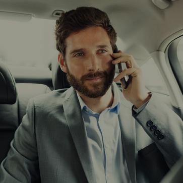 Business Executive in a chauffeur driven car